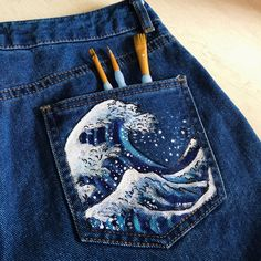 🌊🌊 hand painted with acrylic paint Hokusai 'the. - Depop - Nimmaci's stuff - 🌊🌊 hand painted with acrylic paint Hokusai 'the. - Depop 🌊🌊 hand painted with acrylic paint Hokusai 'the Great high - Depop - Painted Shorts, Painted Jeans, Painted Clothes, Hand Painted, Diy Clothes Paint, Fabric Painting, Diy Painting, Painting On Denim, Denim Paint