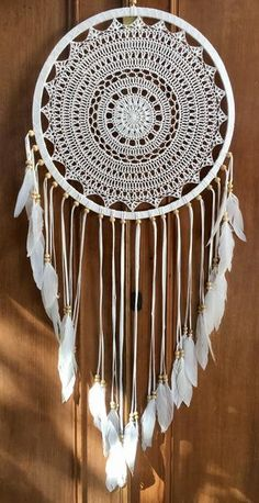 """All white crochet dream catcher with white feathers handmade in Bali, Indonesia. Measures 16.5"""" in diameter."""