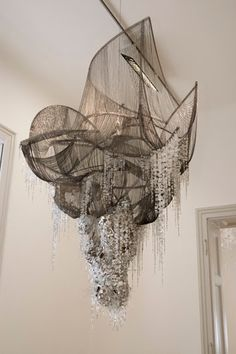 Chandeliers by Lee Bul. Kinda looks like an old tangled fishing net with sea shells and barnacles hanging from it.