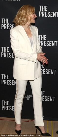 'I've always loved a well-made suit!' The two-time Oscar winner looked chic in her single- buttoned white blazer, matching trousers, and black court shoes selected by stylist Elizabeth Stewart