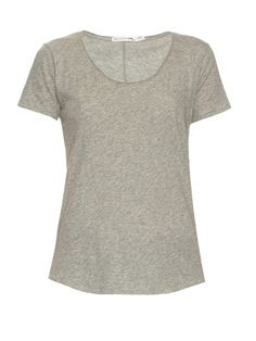 Rag & Bone Slacker short-sleeved cotton T-shirt  Rag & Bone's white Slacker T-shirt is a classic wardrobe staple imbued with a modern sensibility. It has a relaxed shape, and is subtly enlivened with raw trims at the scoop neck and exposed stitching along the back. Layer it for off-duty days with an oversized parka and cropped jeans.