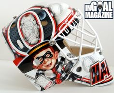 For his new Ottawa Senators mask, prospect Andrew Hammond combined the McDonald's Hamburglar character with Alfred E. Neuman from MAD Magazine fame, strapped him into vintage Vaughn gear, and had him stop some pucks.