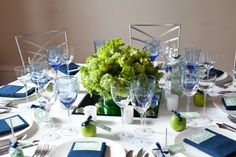white table cloths, navy napkins, green centerpiece and accents (not the speaking kind) lol