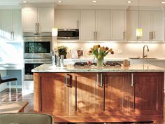 Love the two tone cabinetry and light granite. White in Kitchen. Wood for desk area? Break it up?