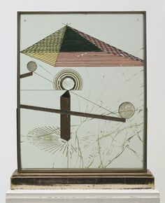 "To Be Looked at (from the Other Side of the Glass) with One Eye, Close to, for Almost an Hour  Marcel Duchamp (American, born France. 1887-1968)    Buenos Aires 1918. Oil, silver leaf, lead wire, and magnifying lens on glass (cracked), mounted between panes of glass in a standing metal frame, 20 1/8 x 16 1/4 x 1 1/2"" (51 x 41.2 x 3.7 cm), on painted wood base, 1 7/8 x 17 7/8 x 4 1/2"" (4.8 x 45.3 x 11.4 cm), Overall 22"" (55.8 cm) high. Katherine S. Dreier Bequest. © 2012 Artists Rights…"