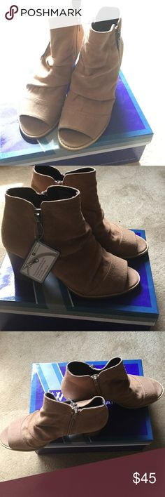 White Mountain walnut/suedette booties. These open toe booties are a size 81/2. Walnuts color and zippers on both side of bottles. One zipper on the outside is ornamental and non-functional. These are new and have never been worn. These are a great boogie to wear with dresses or jeans. Comes in original box. The heel is approximately 3 inches high. White Mountain Shoes Heeled Boots