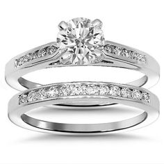 This glamorous diamond bridal set is handcrafted in lustrous 18K white gold. Brilliant H in color and SI1 in clarity round cut GIA certified stone is prong set in the center and weighs 0.74 carats. The side stones which highlight the rest of the engagement ring and the matching wedding band total to 0.50 carats. The engagement ring measures to 5.5 mm in width and the wedding band measures to 2 mm in width. Weighing 6.5 grams $4,448.00