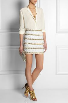 Balmain skirt, Chloé necklace, Equipment top, Christian Louboutin shoes, Jimmy Choo clutch.