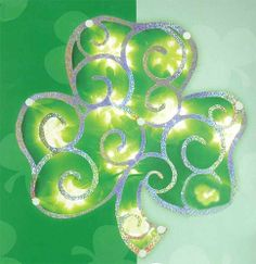 """11"""" Lighted Shimmering St. Patrick's Irish Shamrock Window Silhouette Decoration by Impact. $9.99. Irish Shamrock Window Silhouette DecorationItem #31635Illuminated by 10 clear mini lights on white wireHolographic frame layered over shimmery material creates a prismatic lighting effectOne-sided decorationNo assembly required. Decoration is 1-pieceUL listed for indoor or outdoor use12 Volt replaceable bulbsMaterial(s): durable high impact plastic/glass bulbs/wireDimensions: 11""""H x..."""