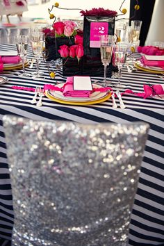 Tablescape palette: all glam with black and white stripes, silver sequins and punchy pink.