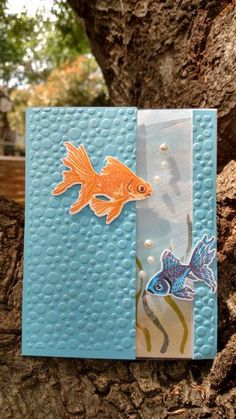 This fun window card features the wonderful Hero Arts Color Layering Goldfish (I re-imagined them as beta fish) and Paper Studio's bubbles embossing folder.  The inside is colored/stamped only in the band that shows through the window.