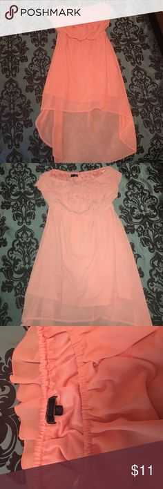 Pink/corral high low dress High low strapless dress. The 2nd picture is with flash. It's a light pink/corral color. Only worn once and in great condition. Medium size and Pearl brand. Feel free to ask questions😊 Pearl Dresses Strapless
