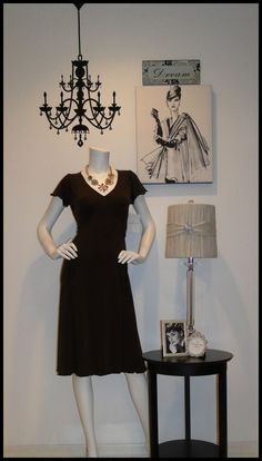 "TGtbT.com says: If you sell both decor items & clothing in your consignment shop, her's a simple way to let your display window show that. (Chandelier is a wallie!) 6 pcs decor, dress & accessories = ""we have it all, come on in!"""