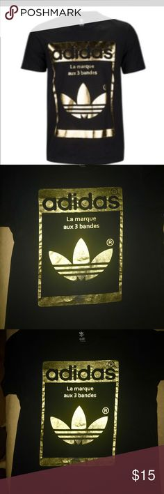 Adidas Extra Lg Gold laminated tee shirt Adidas Extra Large Gold Laminated tee shirt . Good condition. adidas Shirts Tees - Short Sleeve