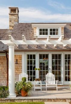 """Attaching a Pergola Structure to the Roof To avoid water infiltration, the pergola beams were designed and detailed to be """"set off"""" the roof by approximately ½"""" from the roof shingles with stainless steel """"T"""" shaped roof clips."""