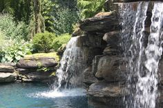 Water Feature Swimming and Landscape in Bergen County NJ : Backyard landscaping and water feature swimming Pool in Saddle River, Bergen County , NJ.   The man made waterfalls are constructed of Pa. colonial boulders.