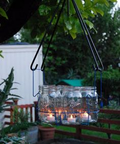 """outdoor chandleir"": wire canning basket filled with jars and tealights...would be cute if the wire basket was spray painted or wrapped in scrap fabric"