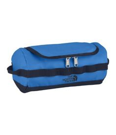 The North Face Base Camp Travel Canister - drummer blue by The North Face. $34.00. Capacity: 15 cubic inches. Material: 1000D Phthalate-free TPE fabric laminate. Manufacturer: The North Face. Weight: 15 oz. This The North Face Base Camp Travel Canister is like having a miniature signature The North Face Duffel for your toiletries. This handy and durable toiletry kit has a hook to hang it up with and a detachable mirror. The D-zip opening makes it easy to find t...