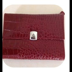 NWT, LRL Wallet Trifold wallet in dark red with silver tone hardware and LRL logo on clasp. Outside zip coin area. Lots of room for cards. NWT. Ralph Lauren Bags Wallets