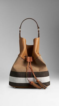 Large Canvas Check Hobo Bag from Burberry - Jute cotton hobo bag in Canvas check with a grainy leather panel. Open top with tasselled drawstring closure. Leather shoulder strap with vintage-finish metal hardware. Interior detachable purse pocket Leather b My Bags, Purses And Bags, Fashion Bags, Fashion Accessories, Leather Tassel, Luxury Bags, Hobo Bag, Swagg, Bucket Bag
