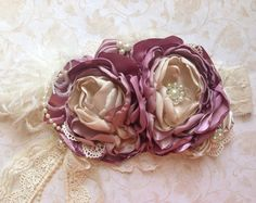 *Please allow 2-3 weeks for processing (not including shipping) rush orders available*  *Please read shop announcement for current policies* Gorgeous colors of deep mauve, light mauve, cream and ivory! With beautiful lace and pearl accents, and a beautiful lace bow hanging down to give it a unique touch. This is a very large over the top headband, but so fun and gorgeous for pictures! Each flower is about 4-5 diameter, and is on a 2 lace elastic headband. Can be made petite (about 3 diameter…