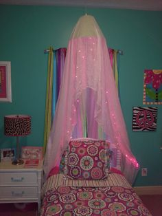 Lamp shade canopy, with pink lights for a girl's bedroom