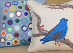 """The Male Indigo Bunting pillow was made with a combination of hand needle-felting and embroidery. The foundational fabric is a free-hand, machine quilted linen. It is 13""""x13"""".    The folk art pillow is made using the traditional penny rug technique of embroidered applique. Concentric wool felt circles are applied using a blanket stitch. This pillow has a heart-shaped design on a mid-tone gray linen. It is 16""""x16"""".    The color-fast quality of Valdani is great! $165 bird pillow."""