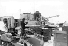 Crews loading a Tiger 1 with new 88mm ammunition supply