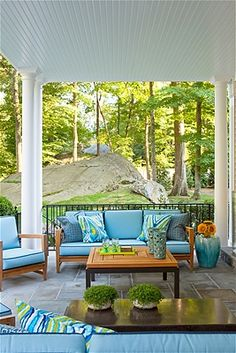 Interior Designer heavyweight David Scott created a veranda in Greenwich, Connecticut, with teak furniture that can weather any mid-summer night's storm. We love the sprightly mix of blue cushions and pillows.