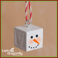 Turn Dollar Store Alphabet Blocks Into This Snowman Ornament