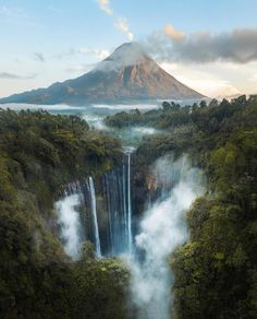 Tumpak Sewu, also known as Coban Sewu a tiered waterfall in Pronojiwo in East Java, Indonesia. The waterfall is overshawdowed by Semeru an active volcano and the highest mountain in Java Drone Photography, Landscape Photography, Nature Photography, Photography Ideas, Waterfalls Photography, Happy Photography, Stunning Photography, Lifestyle Photography, Travel Photography