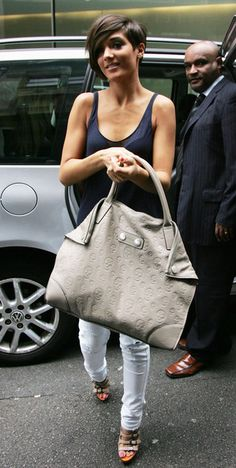 Frankie Sandford - navy blue vest top, white skinny jeans, heels and oversized tote bag