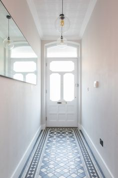 hallway, victorian tiles, victorian hallway tiles, antique mirror, pendant lights, wallpaper ceiling, ceiling tiles, conforth white, industrial pendants, industrial lighting