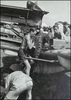 Armoures loading ammo to Messerschmitt Bf 109G-6/R6 of 10./JG 11 Photo: falkeeins.blogspot.com