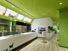 Wienerwald Restaurant Design.     Looks like a nice cross between fast food/casual dining and natural food appeal. Not digging the all green ceiling, though--too much.