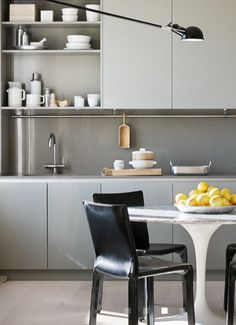 studio karin: love the light in this kitchen and the sage units. Nice open shelves.