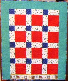 A simple quilt top with an asymmetrical border.