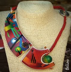 A comprehensive gallery of art jewelry made using polymer clay More