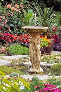 basin-style garden fountain with sculptural pedestal