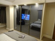 Clarksons of Cheshire are Glass specialists in Alderly Edge, Cheshire. Home of the Mirror TV, Wardrobe TV, Bespoke Sliding Wardrobes & Doors. Call or visit our showroom. Wardrobe Tv, Sliding Wardrobe, Playstation, Xbox, Mirror Tv, Bespoke Design, Apple Tv, Tvs, Living Spaces