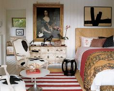 Here a West Elm headboard, John Robshaw linens, Saarinen tulip table, limed-oak armchairs and a 19th-century English portrait create a truly eclectic point of view