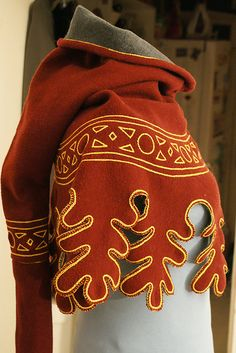 This medieval hood can easily be made from felt. Very little sewing. You can even do it by hand in an hour. To keep it simple I would do the decorating with fabric paint. Instant Burning Man favorite.