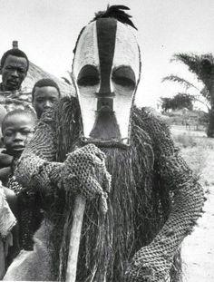 "Africa | Kifwebe masquerader (Bwadi Bwa Kifwebe association).  Songye people, DR Congo | Image taken from ""Beauty and the Beasts - Kifwebe and animal masks of the Songye, Luba and related peoples.""  Marc Leo Felix."
