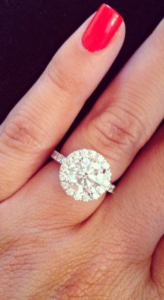 Beautiful round engagement ring paired with a subtle halo