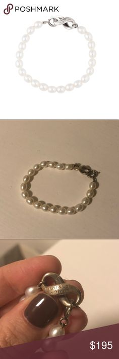 "Tiffany & Co. Infinity Pearl Bracelet 100% authentic. Freshwater pearls with sterling silver clasp. No signs of wear, but the clasp could use a good shine! About 7.5"" in length. No longer have the box or dust bag, but I will ship safely. Feel free to make an offer! Tiffany & Co. Jewelry Bracelets"