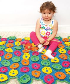 Floral motifs turn a basic baby blanket into a bouquet bound to cheer up any room.