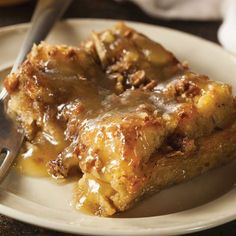This Easy Bread Pudding is topped with caramel sauce and chopped pecans for a rich and crunchy flavor, and it couldn't be simpler to make since it's baked in a slow cooker.data-pin-do=
