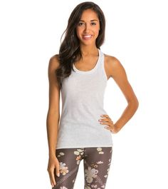 This women's Gaiam top blends a stylishly semi-fitted design fit with a fun, cropped length. PRODUCT FEATURES <ul> <li>Mesh-back panel</li> <li>Boatneck</li> <l -- Read more at the image link. Yoga Tank Tops, Yoga Shorts, Yoga Wear, Racerback Tank Top, Scoop Neck, Raw Edge, How To Wear, Capsule Wardrobe, Spun Cotton
