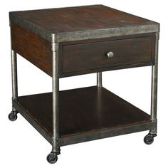 Brimming with industrial appeal, this stylish end table showcases distressed metal framing and caster feet.  Product: End table