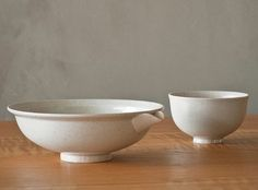 """Iga Bowls  A vessel incorporating fine details upon a rough clay unique it Iga ware. The more you use it the deeper the colors of the surface cracks become, increasing its charm. The expression changing over time is referred to as """"raising the dish"""", and is also part of the enjoyment of Japanese ceramics."""